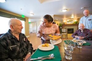 Elders being served breakfast