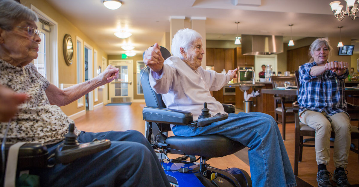 Assisted Living Community Doing Group Exercises