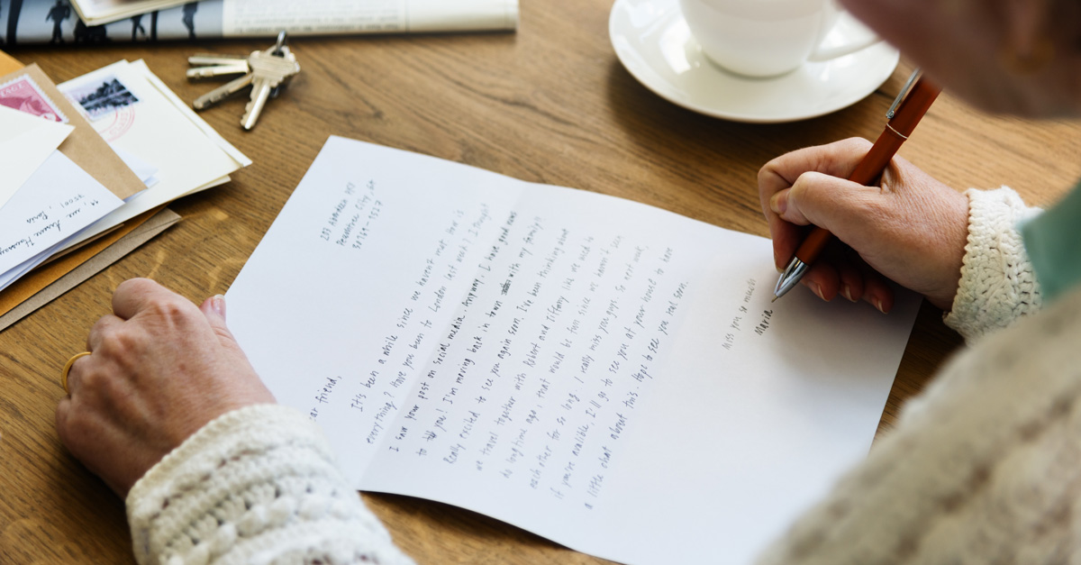 elderly woman writing letter