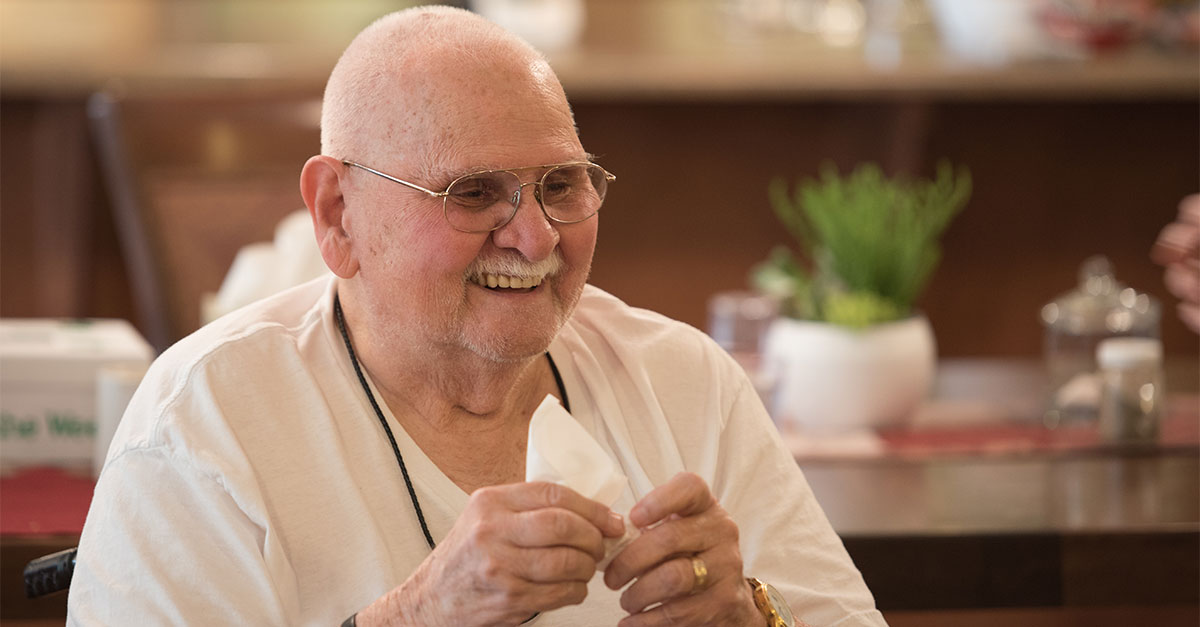 Elderly man laughing